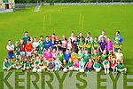 CAMP: Children from Oakpark and the surrounding area who finished up with the Na Gaeil GAA Club Summer amp on Friday. with their mentors