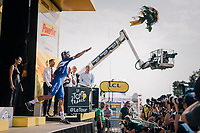 stage winner Fernando Gaviria (COL/Quick Step Floors) throwing his victory flowers into the crowd<br /> <br /> Stage 4: La Baule > Sarzeau (192km)<br /> <br /> 105th Tour de France 2018<br /> ©kramon