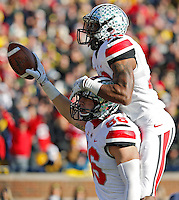 Ohio State Buckeyes tight end Jeff Heuerman (86), bottom, celebrates with Ohio State Buckeyes wide receiver Philly Brown (10) after scoring on a touchdown pass in the 3rd quarter of their college football game at Michigan Stadium in Ann Arbor, Michigan on November 30, 2013.  (Dispatch photo by Kyle Robertson)