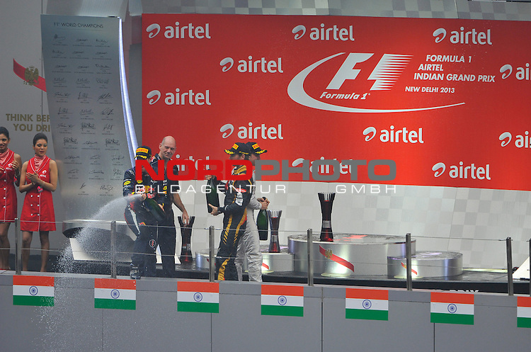 25.-27-10-2013, Jaypee-Circuit, Noida, IND, F1, Grosser Preis von Indien, Noida, im Bild Podium - Sebastian Vettel (GER), Red Bull Racing - Nico Rosberg (GER), Mercedes GP - Romain Grosjean (FRA) Lotus Renault F1 Team - Adrian Newey (GBR), Red Bull Racing (ex. McLaren), Technical Operations Director <br />  Foto &not;&copy; nph / Mathis