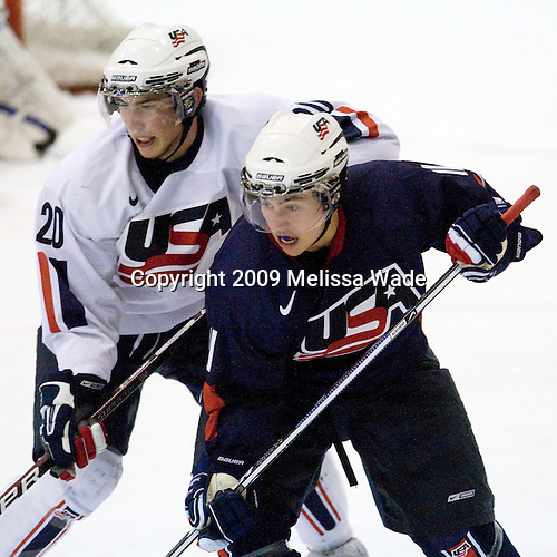 Vinny Saponari (US White - 20), Tyler Johnson (US Blue - 11) - Team White defeated Team Blue 8-7 (OT) in their third scrimmage of the 2009 USA Hockey National Junior Evaluation Camp on Sunday, August 9, 2009, in the USA (NHL-sized) Rink in Lake Placid, New York.