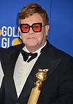 a_Elton Jones 152 poses in the press room with awards at the 77th Annual Golden Globe Awards at The Beverly Hilton Hotel on January 05, 2020 in Beverly Hills, California.