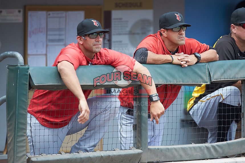 Indianapolis Indians manager Brian Esposito (left) and hitting coach Ryan Long (right) watch the action from the dugout during the game against the Charlotte Knights at BB&T BallPark on August 22, 2018 in Charlotte, North Carolina.  The Indians defeated the Knights 6-4 in 11 innings.  (Brian Westerholt/Four Seam Images)