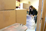PLYMOUTH, CT-- 03 JANUARY 2008--010308JS01-Gina Ritchie, an art teacher at Terryville High School, unpacks classroom supplies on Thursday as staff members get ready to make the transition into the newly built high school.  Ritchie, who taught in the old school for 25 years, said she is looking forward to getting setteled into the new building. <br /> Jim Shannon/Republican-American