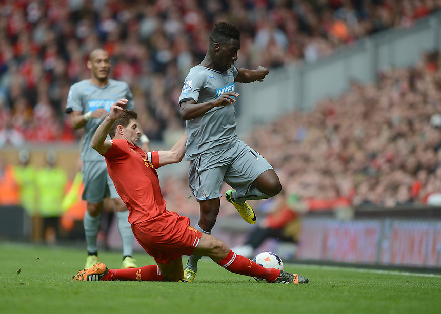 Newcastle United's Massadio Haidara is tackled by Liverpool's Steven Gerrard<br /> <br /> Photographer Ian Cook/CameraSport<br /> <br /> Football - Barclays Premiership - Liverpool v Newcastle United - Sunday 11th May 2014 - Anfield - Liverpool<br /> <br /> &copy; CameraSport - 43 Linden Ave. Countesthorpe. Leicester. England. LE8 5PG - Tel: +44 (0) 116 277 4147 - admin@camerasport.com - www.camerasport.com