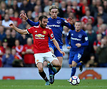 Tom Davies of Everton and Juan Mata of Manchester United during the premier league match at the Old Trafford Stadium, Manchester. Picture date 17th September 2017. Picture credit should read: Simon Bellis/Sportimage