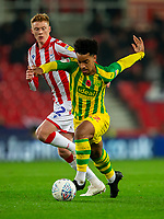 4th November 2019; Bet365 Stadium, Stoke, Staffordshire, England; English Championship Football, Stoke City versus West Bromwich Albion; Matheus Pereira of West Bromwich Albion runs with the ball under pressure from Sam Clucas of Stoke City - Strictly Editorial Use Only. No use with unauthorized audio, video, data, fixture lists, club/league logos or 'live' services. Online in-match use limited to 120 images, no video emulation. No use in betting, games or single club/league/player publications