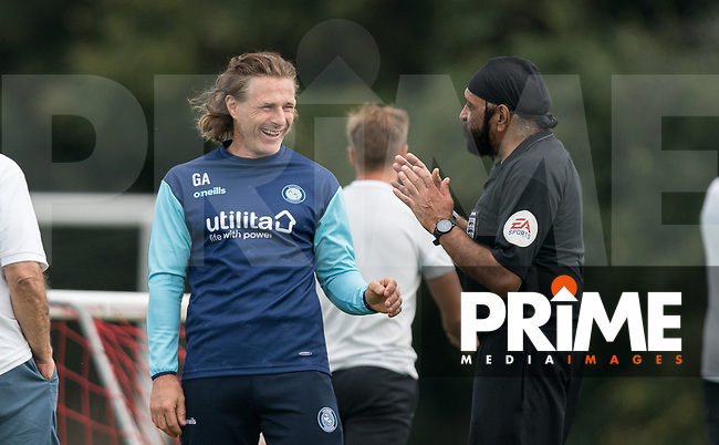 Wycombe Wanderers Manager Gareth Ainsworth & Referee Jarnail Singh during the behind closed doors friendly between Brentford B and Wycombe Wanderers at Brentford Football Club Training Ground & Academy, 100 Jersey Road, TW5 0TP, United Kingdom on 3 September 2019. Photo by Andy Rowland.