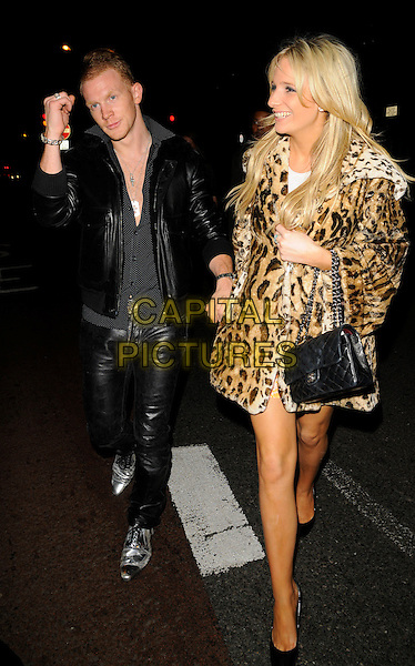 REX NEWMARK & NICOLE CAMMACK.The Swarovski Rocks magazine launch & Giles 10th Collection party, Old Sorting Office, New Oxford St., London, England..September 16th, 2008.full length black leather jacket trousers holding hands leopard print coat bag purse big brother bb8.CAP/CAN.©Can Nguyen/Capital Pictures.