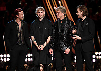 LOS ANGELES- MARCH 14: 5 Seconds of Summer accept the Best Duo or Group award onstage at the 2019 iHeartRadio Music Awards at the Microsoft Theater on March 14, 2019 in Los Angeles, California. (Photo by Frank Micelotta/Fox/PictureGroup)