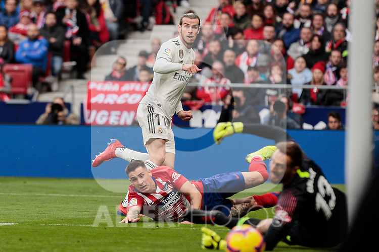 Atletico de Madrid's Jose Maria Gimenez and Real Madrid's Gareth Bale (who scores goal) during La Liga match between Atletico de Madrid and Real Madrid at Wanda Metropolitano Stadium in Madrid, Spain. February 09, 2019. (ALTERPHOTOS/A. Perez Meca)