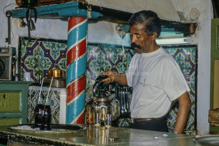 Tunisia, Sidi Bou Said.  Tea Maker Pouring Tea, Cafe des Nattes, an Arab Coffee House.