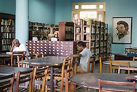 Visitors reading inside the municipal library, Santa Clara, Villa Clara, Cuba.
