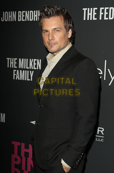 Len Wiseman<br /> The Pink Party 2013 held at the Santa Monica Airport, Santa Monica, California, USA.<br /> October 19th, 2013<br /> half length black suit hand in pocket <br /> CAP/ADM/KB<br /> &copy;Kevan Brooks/AdMedia/Capital Pictures