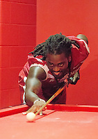 Photo by David Beach -Alex Collins of the Razorbacks play a little pool in the player's lounge during Razorback Football Media Day, Sunday, August 9, 2015.