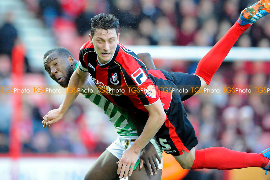 Tommy Elphick of AFC Bournemouth climbs all over Ishmael Miller of Yeovil Town - AFC Bournemouth vs Yeovil Town - Sky Bet Championship Football at the Goldsands Stadium, Bournemouth, Dorset - 26/12/13 - MANDATORY CREDIT: Denis Murphy/TGSPHOTO - Self billing applies where appropriate - 0845 094 6026 - contact@tgsphoto.co.uk - NO UNPAID USE