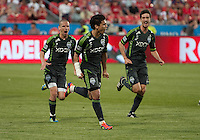 Seattle Sounders FC forward Fredy Montero #17 celebrates after scoring the winning goal during an MLS game between the Seattle Sounders FC and the Toronto FC at BMO Field in Toronto on June 18, 2011..The Seattle Sounders FC won 1-0.