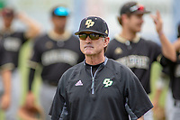 Cal Poly San Luis Obispo Mustangs head coach Larry Lee watches pre-game warm-ups before the game against the UC-Riverside Highlanders at Riverside Sports Complex on May 26, 2018 in Riverside, California. The Cal Poly SLO Mustangs defeated the UC Riverside Highlanders 6-5. (Donn Parris/Four Seam Images)