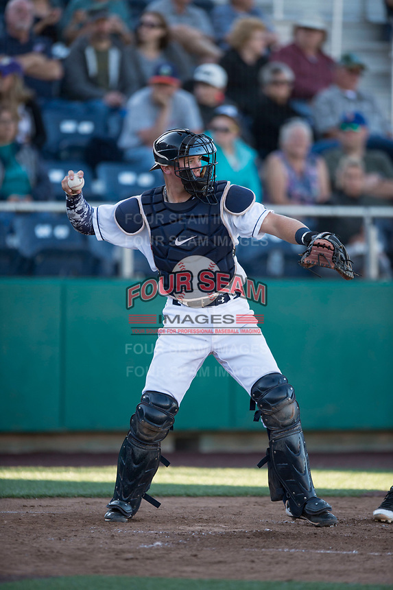 Everett AquaSox catcher Troy Dixon (34) throws back to the pitcher during a Northwest League game against the Tri-City Dust Devils at Everett Memorial Stadium on September 3, 2018 in Everett, Washington. The Everett AquaSox defeated the Tri-City Dust Devils by a score of 8-3. (Zachary Lucy/Four Seam Images)