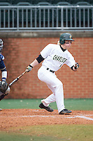Brett Netzer (9) of the Charlotte 49ers follows through on his swing against the Akron Zips at Hayes Stadium on February 22, 2015 in Charlotte, North Carolina.  The Zips defeated the 49ers 5-4.  (Brian Westerholt/Four Seam Images)