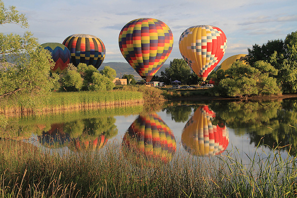 Hot air balloon and reflection in lake, Boulder, Colorado, USA.