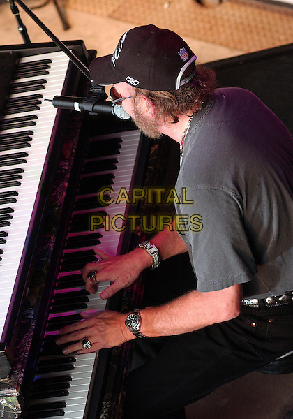 HANK WILLIAMS JR.Performs at Jamboree In The Hills.Morristown, 16th July 2005.country music singing microphone grey t-shirt sunglasses    .baseball hat half length half-length piano.www.capitalpictures.com.sales@capitalpictures.com.© Capital Pictures.