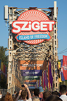 Revellers arrive to the main gate of Sziget Festival held in Budapest, Hungary on Aug. 8, 2018. ATTILA VOLGYI
