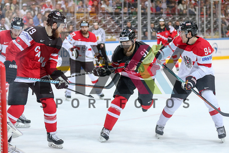 Canadas Seguin, Tyler (Nr.91) und Canadas O'Reilly, Ryan (Nr.79) vor dem Tor von Oestereichs Starkbaum, Bernhard (Nr.29) im Zweikampf mit Oestereichs Cijan, Alexander (Nr.94)  im Spiel IIHF WC15 Kanada vs. Oestereich.<br /> <br /> Foto &copy; P-I-X.org *** Foto ist honorarpflichtig! *** Auf Anfrage in hoeherer Qualitaet/Aufloesung. Belegexemplar erbeten. Veroeffentlichung ausschliesslich fuer journalistisch-publizistische Zwecke. For editorial use only.