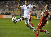 Leaping US midfielder Clint Dempsey (8) receives a long ball in front of Poland defender Lukasz Mierzejewski (2).  The U.S. Men's National Team tied Poland 2-2 at Soldier Field in Chicago, IL on October 9, 2010.