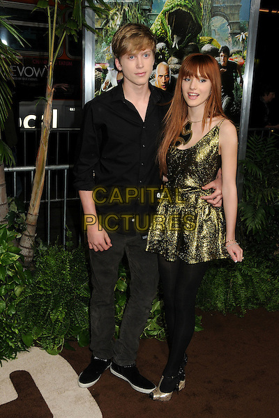 "Garrett Backstrom & Bella Thorne.""Journey 2: The Mysterious Island"" Los Angeles Premiere held at Grauman's Chinese Theatre, Hollywood, California, USA..February 2nd, 2012.full length dress black tights gold necklace sparkly shirt jeans denim couple .CAP/ADM/BP.©Byron Purvis/AdMedia/Capital Pictures."