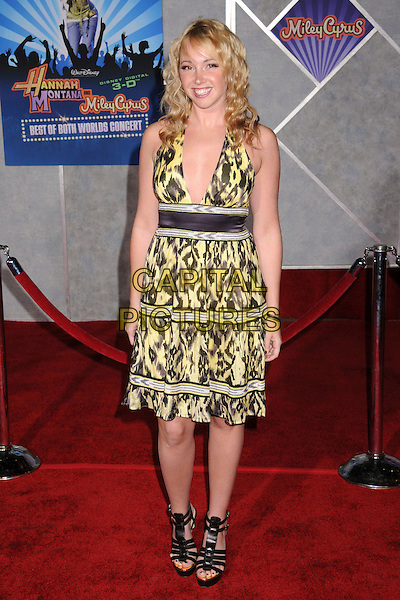 "JENNIFER TISDALE.Disney's ""Hannah Montana & Miley Cyrus: Best of Both Worlds"" Concert Premiere at the El Capitan Theatre, Hollywood, California, USA..January 17th, 2008.full length black yellow leopard print dress shoes striped stripes halterneck .CAP/ADM/BP.©Byron Purvis/AdMedia/Capital Pictures."