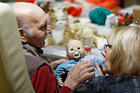 Pictured: John Williams with Sandra Forbes, Senior Communities Services Officer.  Thursday 12 December 2019<br /> Re: Realistic looking baby dolls used for therapy at the Oaklands Day Centre in Rhymney near Tredegar south Wales, UK.
