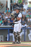 Jose Queliz (30) of the Hillsboro Hops in the field at catcher during a game against the Salem-Keizer Volcanoes at Ron Tonkin Field on July 27, 2015 in Hillsboro, Oregon. Hillsboro defeated Salem-Keizer, 9-2. (Larry Goren/Four Seam Images)