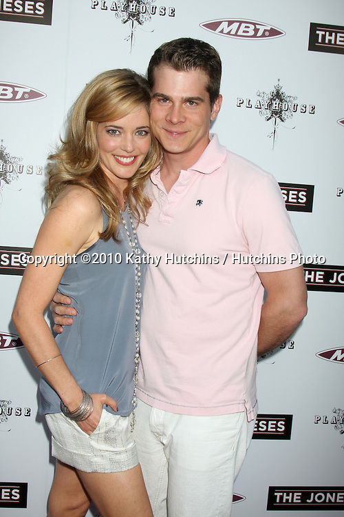 """.Christina Moore & husband John Ducey.arrives at """"The Joneses"""" Premiere.ArcLight Theaters.Los Angeles, CA.April 7, 2010.©2010 Kathy Hutchins / Hutchins Photo..."""