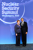 United States President Barack Obama welcomes President Tarja Halonen of Finland to  the Nuclear Security Summit at the Washington Convention Center, Monday, April 12, 2010 in Washington, DC. .Credit: Ron Sachs / Pool via CNP