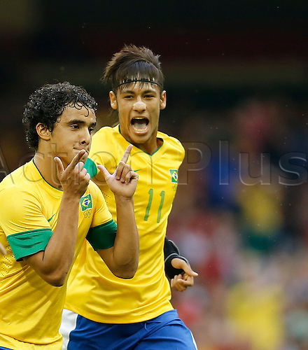26.07.2012 Cardiff, Wales. Brazilian Rafael (L) celebrates goal with striker Neymar during the match against Egypt in Group C of the London Olympics in 2012 Millennium Stadium in Cardiff, Wales. Brazil won 3-2.