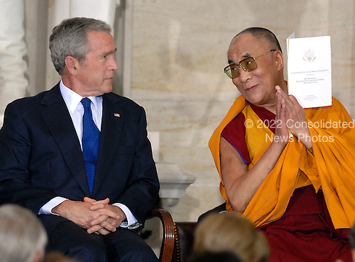 Washington, DC - October 17, 2007 -- United States President George W. Bush shares some words with The 14th Dalai Lama, Tenzin Gyatso, who was at The Capitol in Washington, D.C., to accept the Congressional Gold Medal, the nation's highest and most distinguished civilian award, on Wednesday, October 17, 2007. .Credit: Ron Sachs/CNP