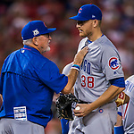 7 October 2017: Chicago Cubs pitcher Mike Montgomery takes the ball from Manager Joe Maddon in the 8th inning against the Washington Nationals at Nationals Park in Washington, DC. The Nationals defeated the Cubs 6-3 and even their best of five Postseason series at one game apiece. Mandatory Credit: Ed Wolfstein Photo *** RAW (NEF) Image File Available ***