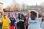 Students and community members stretch and warm-up before the first annual Wellness Revolution 5K Run and Walk on the Spelman College campus in Atlanta, Georgia April 6, 2013.