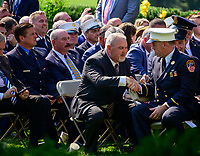 From left: Gerard Fitzgerald, Uniformed Firefighters Association president, and Jake Lemonda, President of the Uniformed Fire Officers Association, look on as Philip Alvarez shakes hands with former fire chief of the Midtown Manhattan firehouse Chief John Joyce prior to United States President Donald J. Trump signing H.R. 1327, an act to permanently authorize the September 11th victim compensation fund, in the Rose Garden of the White House in Washington, DC on Monday, July 29, 2019. <br /> Credit: Ron Sachs / Pool via CNP/AdMedia