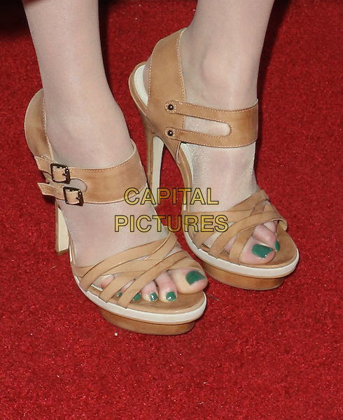 KAREN GILLAN's shoes.The BritWeek 2010 Champagne Launch held At The British General Consul Residence, Los Angeles, California, USA..April 20th, 2010.feet heels beige brown sandals green toe toes nail varnish polish detail.CAP/ADM/KB.©Kevan Brooks/AdMedia/Capital Pictures.