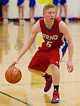 Reno's Colten Crom looks to drive against Galena in their Northern Region Division I boys basketball game played at Galena High School on Tuesday night, Feb. 17, 2015.