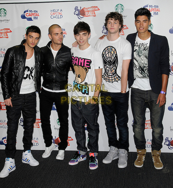 THE WANTED - Tom Parker, Max George, Nathan Sykes, Jay McGuiness & Siva Kaneswaran.The Capital FM Summertime Ball, Wembley Stadium, London, England..June 12th, 2011.full length black leather jacket white top blue navy band group jeans denim.CAP/CAN.©Can Nguyen/Capital Pictures.