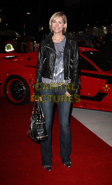 JENNI FALCONER .UK Premiere of 'Kick-Ass' at the Empire cinema, Leicester Square, London, England, UK, March 22nd 2010.arrivals full length jeans bag biker  grey gray black leather top  silver  sequined sequin beaded fingerless gloves .CAP/ROS.©Steve Ross/Capital Pictures.