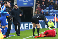 Referee Anthony Taylor check Kyle Naughton of Swansea is okay during the Premier League match between Leicester City and Swansea City at the King Power Stadium, Leicester, England, UK. Saturday 03 February 2018