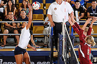 24 September 2010:  FIU's Jessica Gehrke (2) hits a kill shot in the first set as the FIU Golden Panthers defeated the University of Denver Pioneers, 3-0 (29-27, 25-16, 25-20), at U.S Century Bank Arena in Miami, Florida.