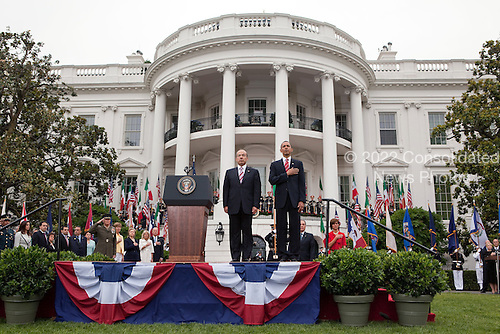 United States President Barack Obama and President Felipe Calderón of Mexico stand together during the playing of the national anthem on the South Lawn of the White House, Wednesday, May 19, 2010. .Mandatory Credit: Pete Souza - White House via CNP