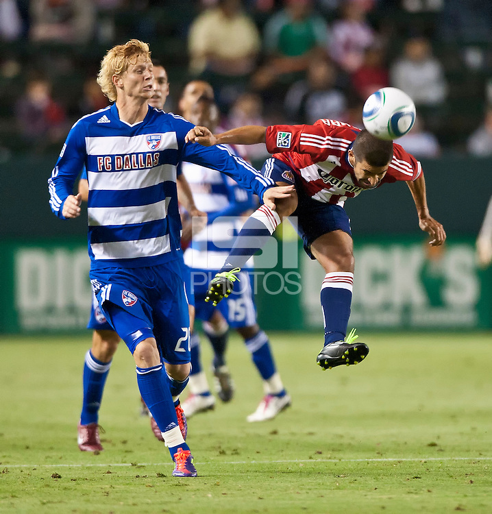 CARSON, CA – June 18, 2011: Chivas USA midfielder Paulo Nagamura (5) heads the ball past FC Dallas midfielder Brek Shea (20)during the match between Chivas USA and FC Dallas at the Home Depot Center in Carson, California. Final score Chivas USA 1, FC Dallas 2.