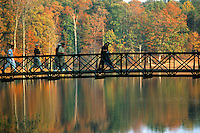Tiger and teammate Notah V walk across a bridge during The 1999 Presiden't Cup held at Robert Trent Jones( RTJ) in Gainsville, Virginia.