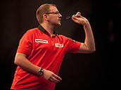 21.12.2014.  London, England.  William Hill World Darts Championship.  Mark Webster (31) [WAL] in action during his game with Ron Meulenkamp [NED]. Webster won the match 3-1.